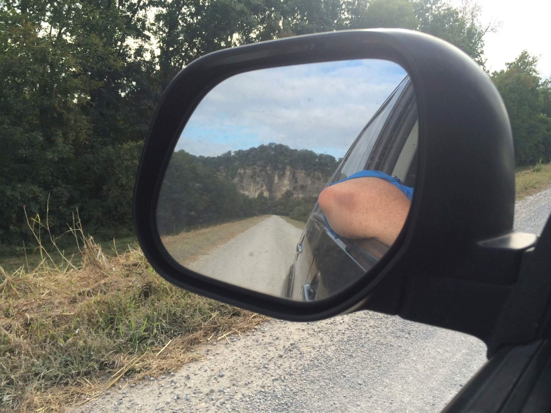 Car leaving with shawnee national forest showing in the rear mirror